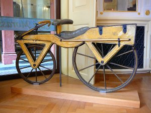 1200px-Draisine_or_Laufmaschine,_around_1820._Archetype_of_the_Bicycle._Pic_01.jpg
